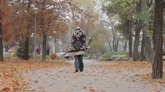 Strange man wandering in city park covered with blanket, mentally ill person Stock Footage