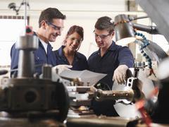 Engineer Teaching Apprentices Stock Photos