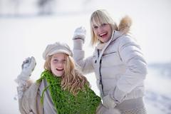 Girls doing a snowball fight Kuvituskuvat