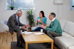 Financial adviser talking to couple Kuvituskuvat