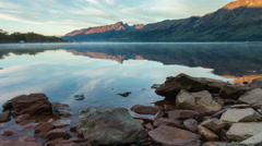 Morning Timelapse at Lake Wakatipu with shadow creeping at the mountains Stock Footage