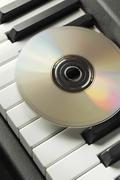 piano and CD - stock photo