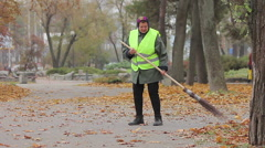 Tired woman working hard as street cleaner, low paid manual labor, poverty Stock Footage