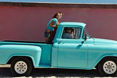5 young people traveling in pickup truck Stock Photos