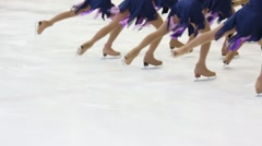 Legs of graceful girls team skating on ice rink during competition Stock Footage