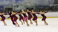 Girls and boy in red perform at Synchronized Figure Skating Cup Stock Footage