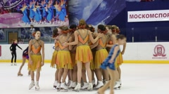 Team in yellow after performance at Synchronized Figure Skating Cup Stock Footage