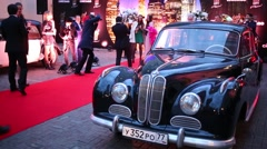 Retro car and people at celebration of first year of LF City magazine Stock Footage