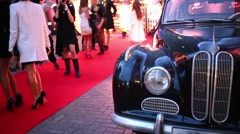Headlight of retro car and legs of people during event Stock Footage