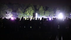 Silhouettes of people during night show in summer park Stock Footage
