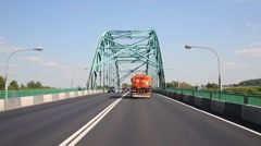 Cars move on road on bridge at summer. Text on truck: flammable - stock footage