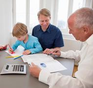 Advisor discussing papers with a father - stock photo