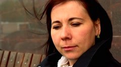 Woman sitting on the banch Stock Footage