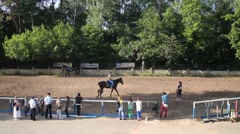 Paddock for horse training and people ride on horses Stock Footage
