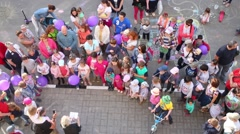 Top view of children with parents in Elk Island residential complex Stock Footage