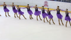 Girls in dresses perform at Synchronized Figure Skating Cup Stock Footage