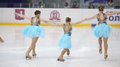 Girls in blue dresses skate at Synchronized Figure Skating Cup Stock Footage