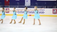 Girls in costumes skate at Synchronized Figure Skating Cup Stock Footage