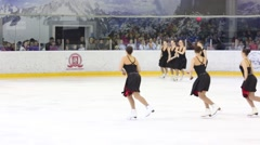 Girls in black dresses skate at Synchronized Figure Skating Cup - stock footage