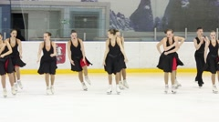 Team in black dresses skates at Synchronized Figure Skating Cup Stock Footage