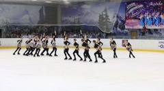 Team in black costumes skates at Synchronized Figure Skating Cup Stock Footage