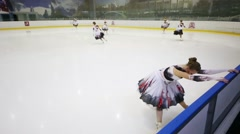 Girls prepare to perform at Synchronized Figure Skating Cup Stock Footage