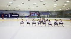 Girls in costumes perform at Synchronized Figure Skating Cup Stock Footage