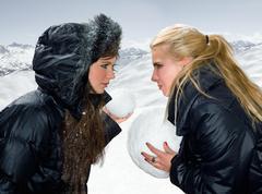Teen girls snowball fight Kuvituskuvat