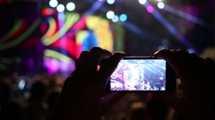 Hands hold phone, that shoots video during show in night club Stock Footage
