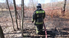 Firefighter in uniform after extinguish forest fire. Stock Footage