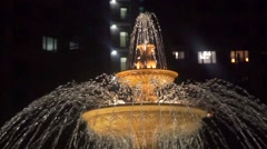Slow motion shot of a beautiful fountain at night Stock Footage