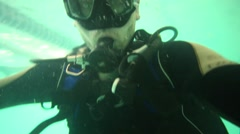 Close up view of man with special equipment diving in pool Stock Footage