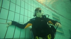 Girl and woman in wetsuits Camaro underwater with scubas Stock Footage