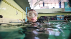 Woman dives in pool of Universal Sports and Show Complex Stock Footage