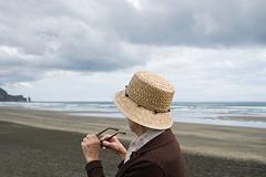 Senior woman on Piha Beach, Auckland Stock Photos