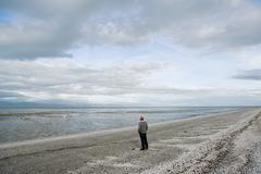Man at Firth of Thames, Kaiaua Stock Photos