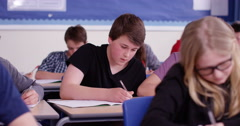 4k, School boy caught cheating using internet during his exam. Slow motion. Stock Footage