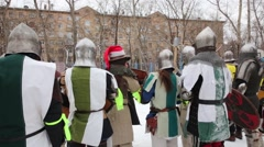 View from back to medieval warriors in armor. Stock Footage