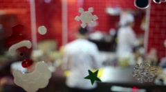 Christmas decorations on glass front of kitchen in restaurant Stock Footage