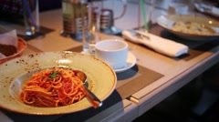 Table on which there are plates of spaghetti, ravioli, soup Stock Footage