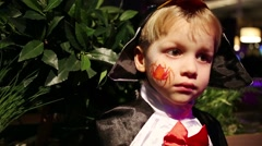 Cute smiling boy in fancy dress with spider painted on cheek Stock Footage