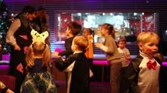 Two activities organizers entertain children in Siren cafe Stock Footage