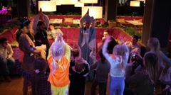 Three activities organizers entertain children in Siren cafe Stock Footage
