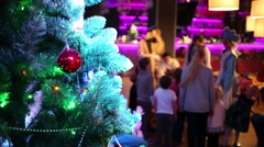 Decorated Christmas tree and children out of focus during holiday Stock Footage
