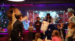 Russian Father Frost entertained children in Siren cafe - stock footage