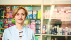 Female pharmacist standing at counter in pharmacy Stock Footage