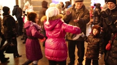 Two girls dance among crowd at annual Christmas Fair of GUM Stock Footage