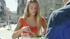 Couple having a date at cute little cafe - stock footage