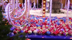 Christmas decorations in store - bright red and blue shiny balls Stock Footage