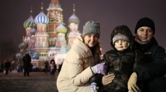 Happy mother, father and little son on Red square at winter Stock Footage